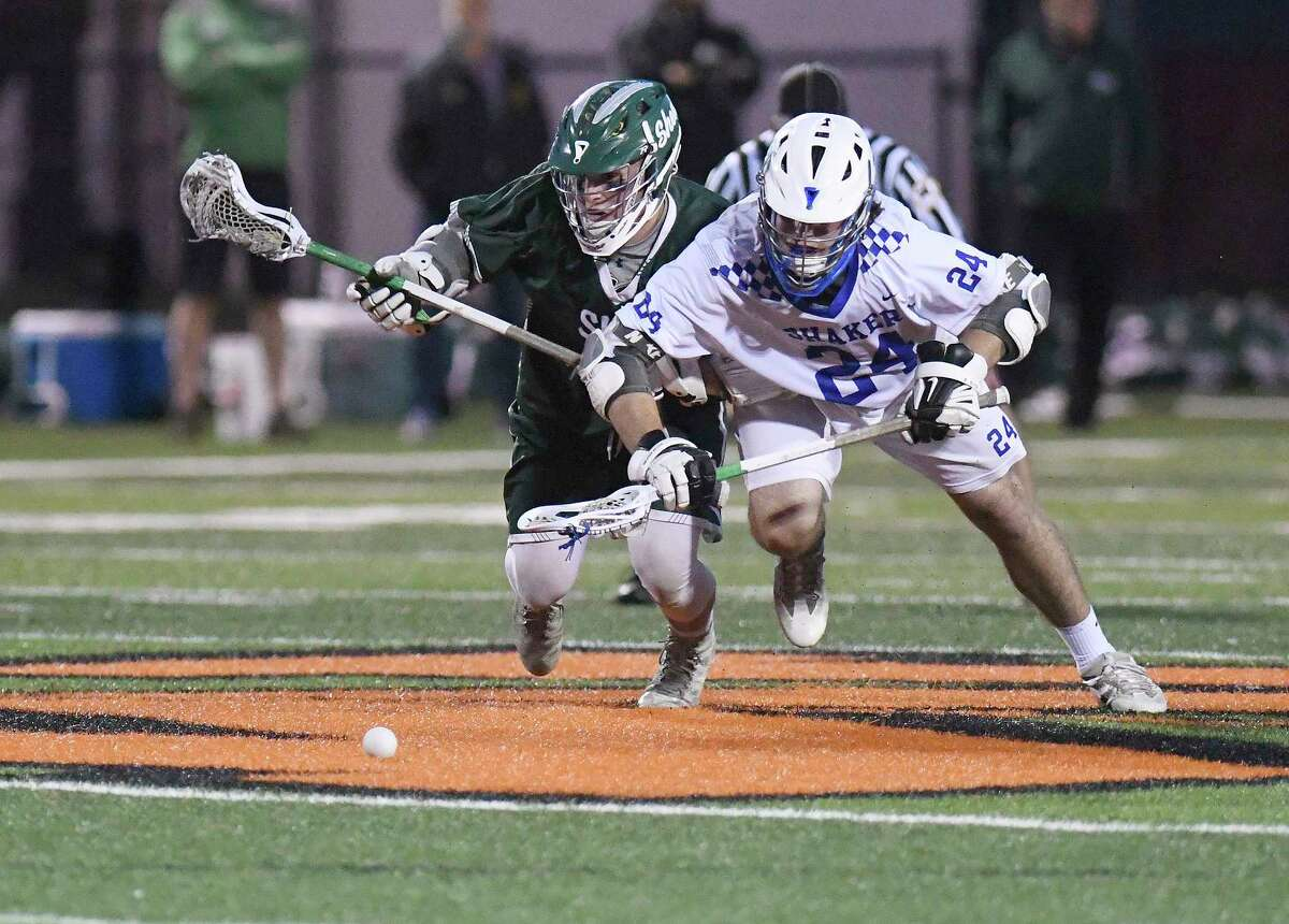 Shenendehowa's Hayden Haldane (8) and Shaker's Aidan Feurer (24) battle for the ball during a face-off during a Section II Class A boys high school lacrosse final in Rotterdam, N.Y., Wednesday, May 31, 2017. (Hans Pennink / Special to the Times Union) ORG XMIT: HP106