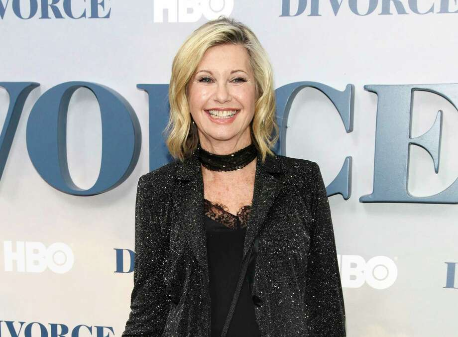 """In this Oct. 4, 2016 file photo, actress and singer Olivia Newton-John attends the premiere of HBO's """"Divorce"""" in New York. Newton-John says she has breast cancer and is canceling her June tour. The 68-year-old singer announced Tuesday, May 30, 2017, that she initially thought she was suffering from back pain, but learned it was """"breast cancer that has metastasized to the sacrum."""" Photo: Andy Kropa / Invision"""