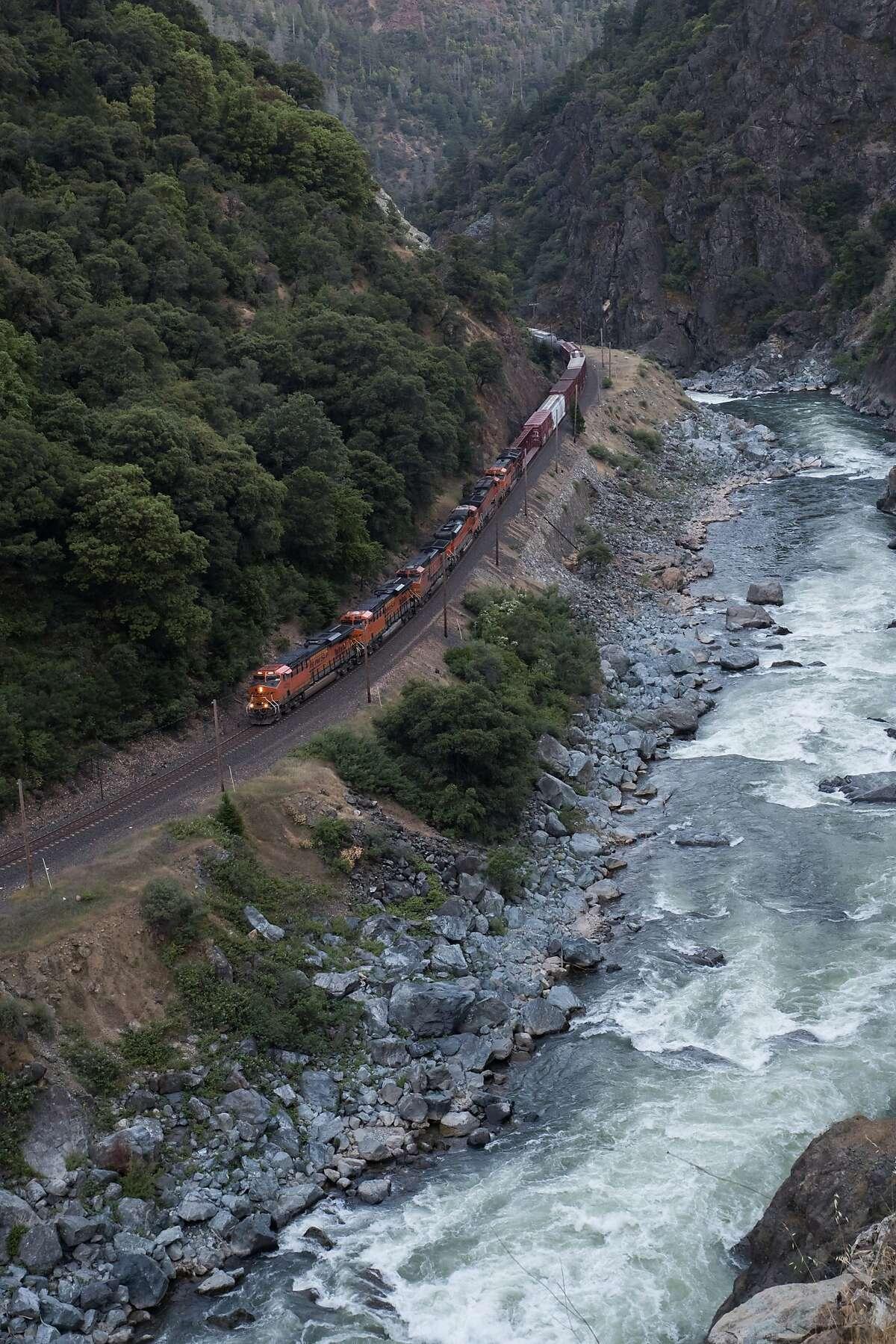Freight train heading toward Pulga Bridge along Feather River and SR 70 at Pulga Road on Sunday, May 28 2017 in Plumas County, CA.