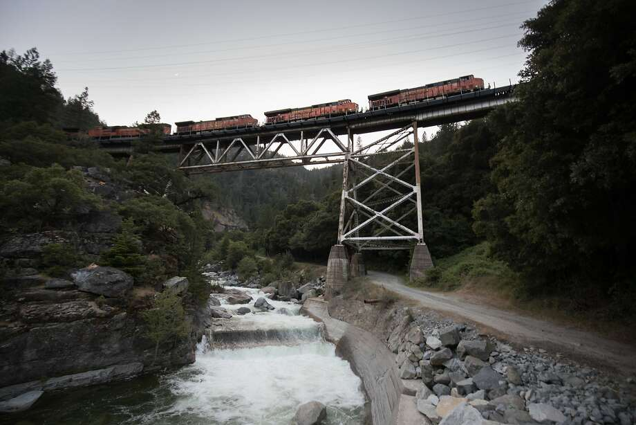A freight train crosses a trestle high above the Feather River. Passenger trains stopped running along the scenic Plumas County byway decades ago, though freight trains traverse the trestle daily. Photo: Paul Kuroda, Special To The Chronicle