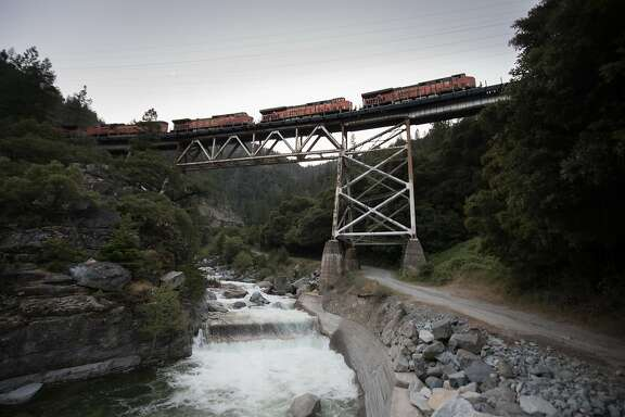 Freight train crosses a trestle along SR 70 on Sunday, May 28 2017 in Plumas County, CA.