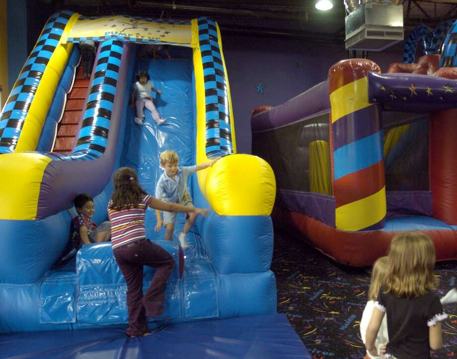 Pump It Up extended its lease in Norwalk, Conn., where it runs an inflatable playground and other activities for kids and organized events. Photo: Johnny Hanson / For The Chronicle / Freelance