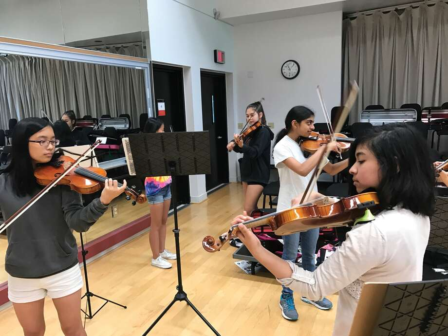 Members of SIUE Suzuki Tour Group rehearse ahead of their June 4 performance at Powell Hall in St. Louis. Photo: For The Intelligencer