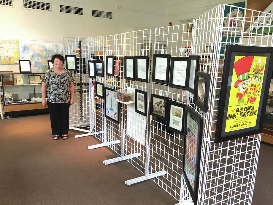 Glen Carbon Heritage Museum Coordinator Linda Sinco stands by the newest display at the Museum. Sinco created a special display of the history of Glen Carbon in celebration of the Village's 125th Anniversary. Photo: Bill Tucker • Intelligencer