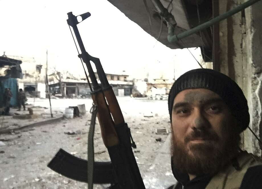 This undated 2016 photo, made available by Syrian rebel fighter Tarek Muharram, shows Muharram  posing for a photo with a weapon in the northwestern province of Idlib, Syria. Muharram, 39, who quit his banking job in the Gulf to return home and join the rebellion in 2012, is nowadays based in Gaziantep, southeastern Turkey. Over the years he fought alongside several different rebel groups, including ones backed by the United States. Now he has now joined the alliance led by the al-Qaida-linked Hayat Tahrir al-Sham. (Courtesy of Tarek Muharram via AP) Photo: Uncredited, HONS / Associated Press / Courtesy of Tarek Muharram