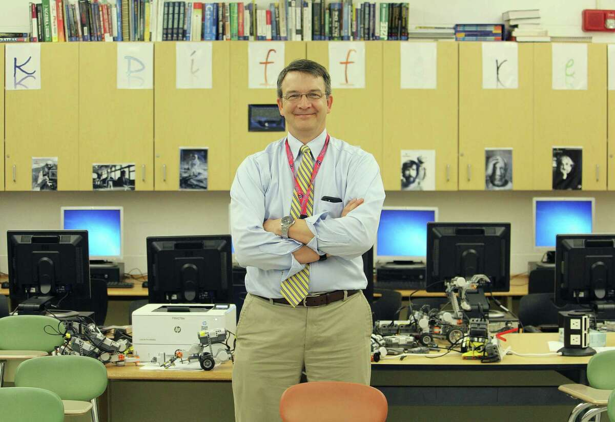 Paul Zhitomi, a business education teacher at Fairfield Warde High School, in his classroom May 31, 2017 in Fairfield, Conn.