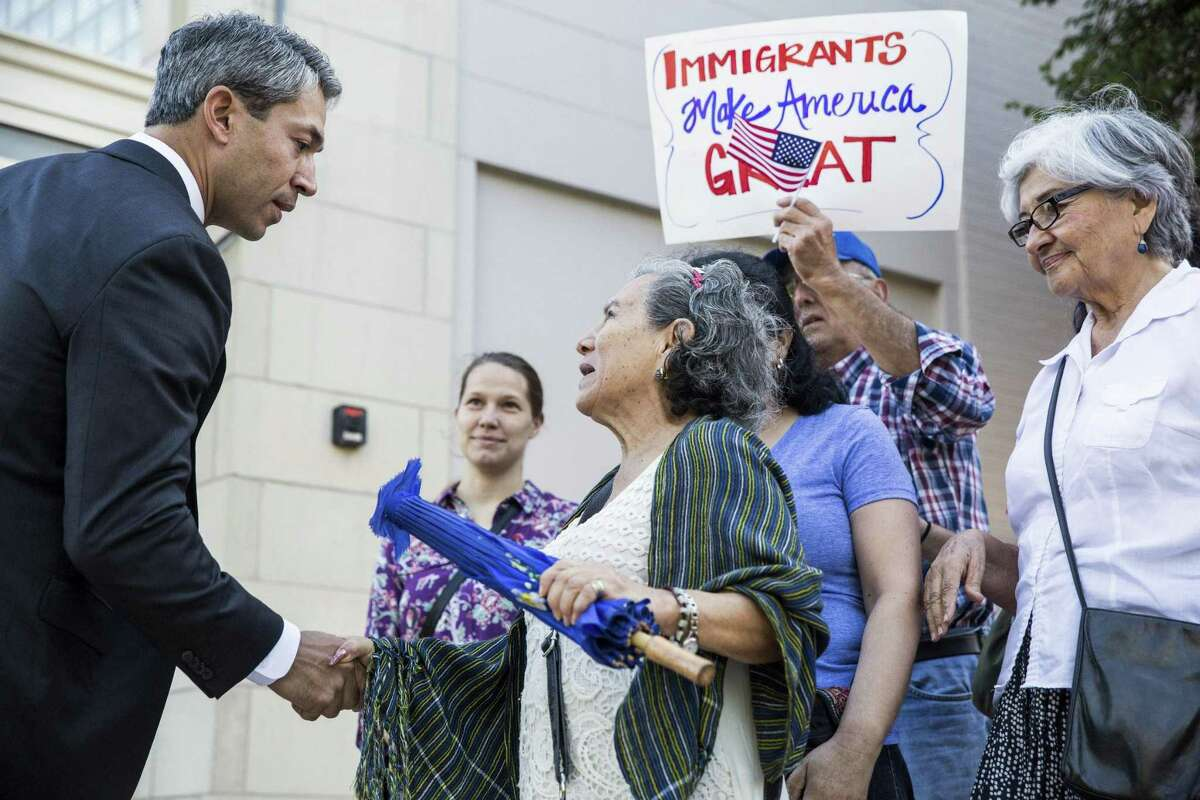 Councilman Ron Nirenberg listens to Elsa Gomez during a demonstration to ask the city to file a lawsuit against S.B. 4 at the Municipal Plaza building in San Antonio, Texas on May 25, 2017. Ray Whitehouse / for the San Antonio Express-News