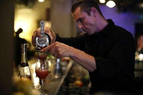 Bartender Alex Conde, a Chronicle Bar Star, makes a drink at Benjamin Cooper.