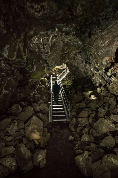Metal stairs provide access to Merrill Cave, one of more than 700 caves in Lava Beds National Monument. Photo: Paul Kuroda, Special To The Chronicle
