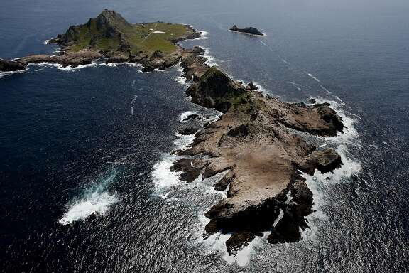 A view of the Farallon Islands.  The sailing vessel can be seen on the left side of the island in the foreground. The sailing vessel Low Speed Chase lay on its side on the Farallon Islands Monday April 16, 2012.  Five people lost their lives during a race Saturday.