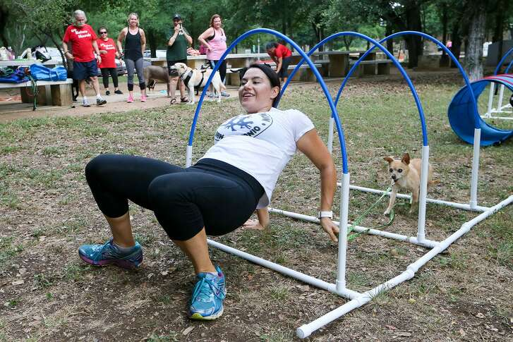 Angi Aramburu demonstrates the proper way to traverse an obstacle course with her dog, Chiquita.