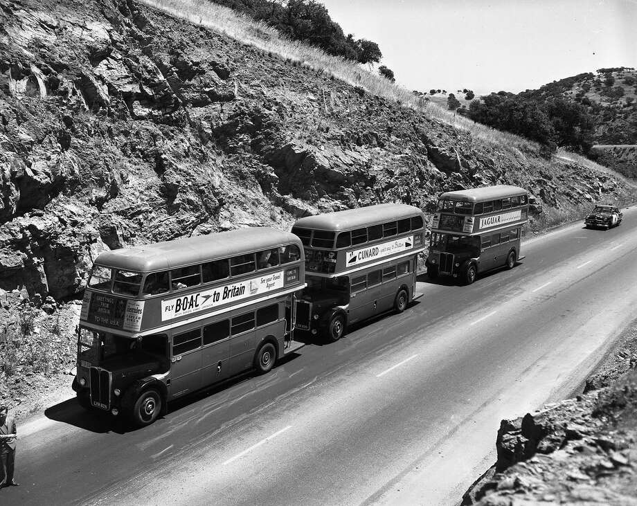 Three London double-decker buses drive across the United States to promote tourism to Great Britain. Photo: Ken McLaughlin, The Chronicle