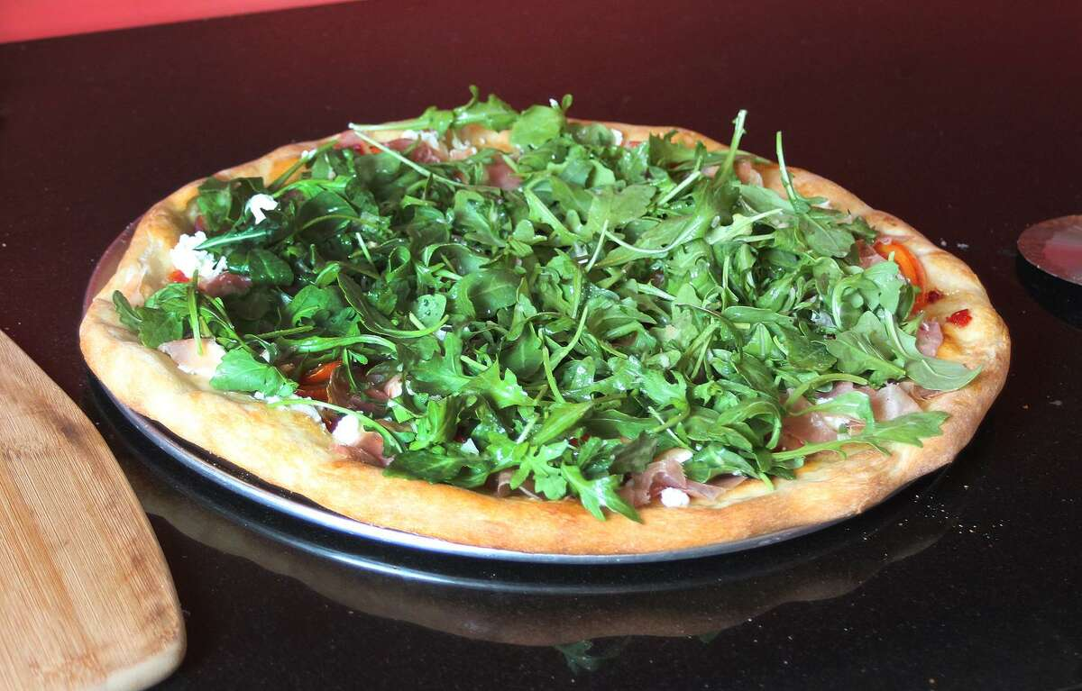 A freshly made goat cheese and arugula salad pizza from PIY, made at a home in Ridgefield, Conn., on Wednesday, May 31, 2017.