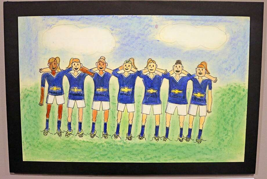 My Soccer Team by Cate Adams is a colored pencil drawing of members of her soccer team joining arm-in-arm after winning a game. Photo: Contributed Photo / Maritime Aquarium