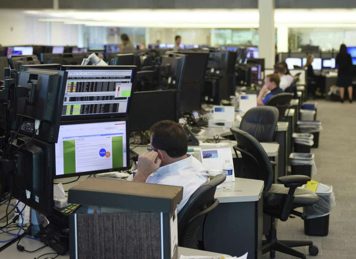 Investment professionals work on the trading floor at Point72 Asset Management's global headquarters in Stamford, Conn. Monday, July 18, 2016.