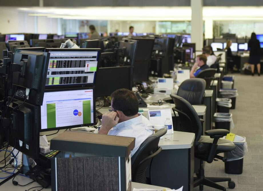 Investment professionals work on the trading floor at Point72 Asset Management's global headquarters in Stamford, Conn. Monday, July 18, 2016. Photo: Tyler Sizemore / Hearst Connecticut Media / Greenwich Time
