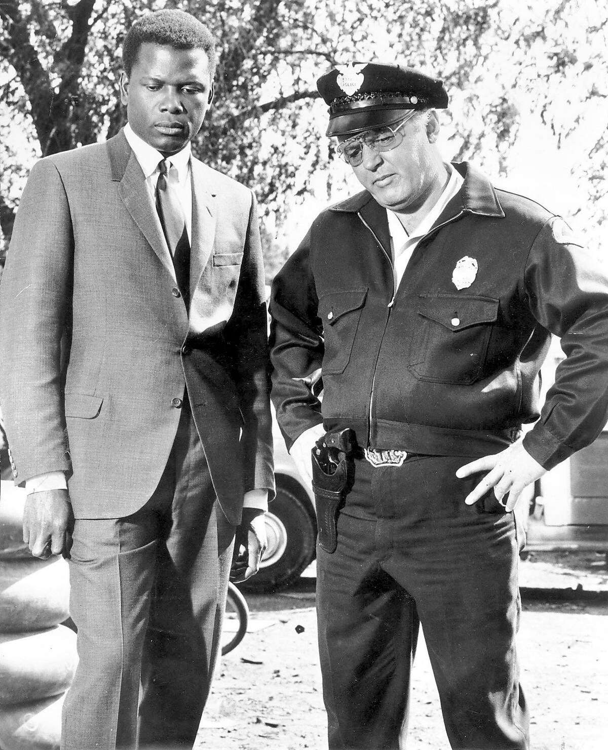 """(NYT3) UNDATED -- July 9, 2002 -- OBIT-STEIGER-B&W -- Rod Steiger, who won the 1967 Oscar for best actor for his role as the redneck Southern police chief in """"In the Heat of the Night,"""" died Tuesday. He was 77. Steiger, right, with Sidney Poitier in the film. (United Artists/The New York Times) *LITE ALSO Ran on: 01-27-2008"""