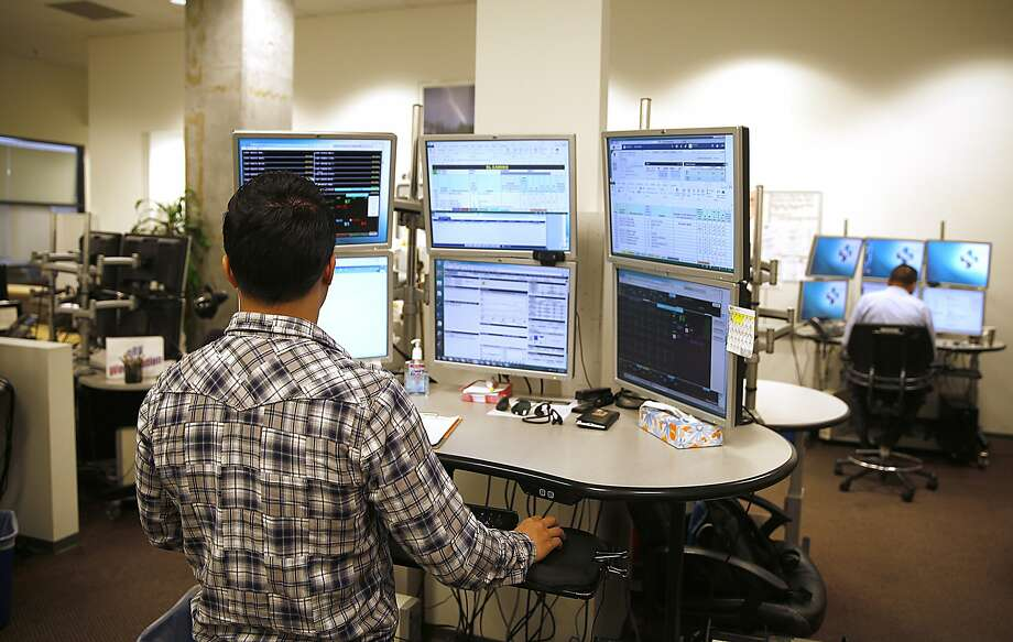 Unit coordinator Ricky Ng does prep work for recently admitted patients and supports patient information for critical care nurses at California Pacific Medical Center's eICU hub. Photo: Liz Hafalia, The Chronicle