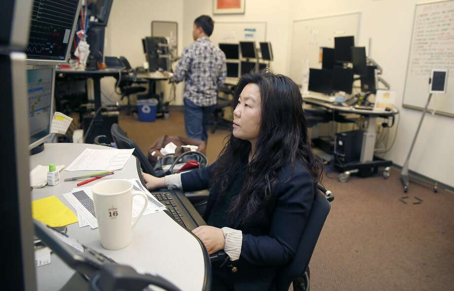 Critical care nurse Belinda Kwan monitors ICU patients at California Pacific Medical Center's eICU hub. Photo: Liz Hafalia, The Chronicle