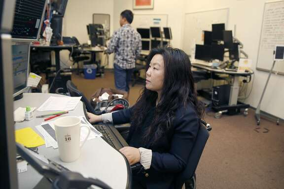 Critical care nurse Belinda Kwan monitors ICU patients at California Pacific Medical Center's eICU hub where  nurses and doctors remotely monitor ICU patients off-site via computer screens on Wednesday, May 31, 2017,  in San Francisco, Calif.