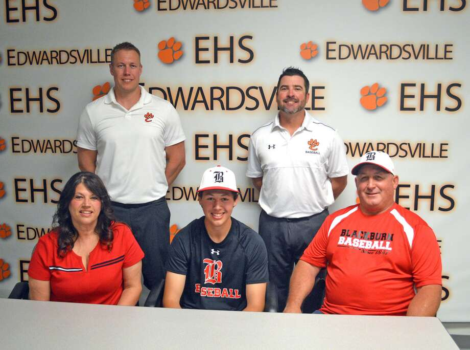 Edwardsville senior Isaac Garrett will play baseball and golf at Blackburn College. In the front row, from left to right, are mother Angie Garrett, Isaac Garrett and father Don Garrett. In the back row, from left to right, are EHS boys' golf coach Adam Tyler and EHS baseball coach Tim Funkhouser.