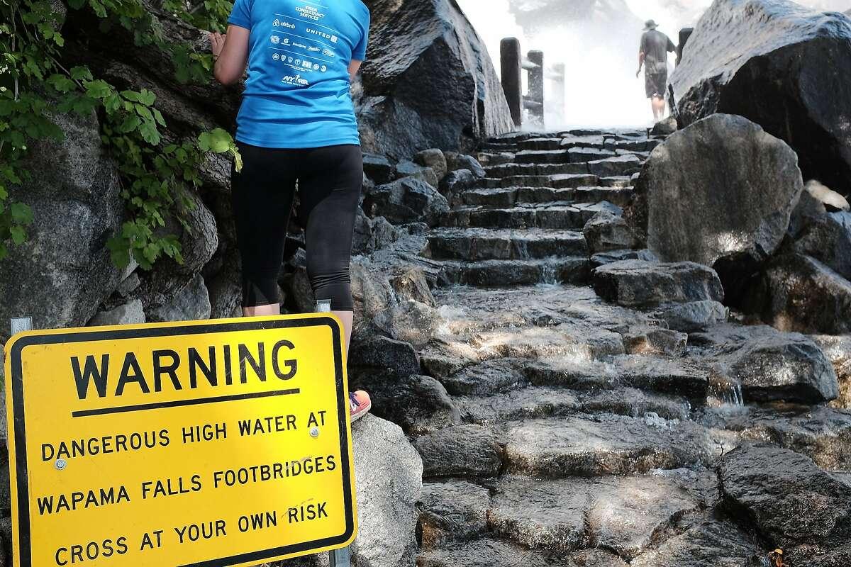 A sign warns that crossing the Wapama Falls Footbridges can be dangerous.