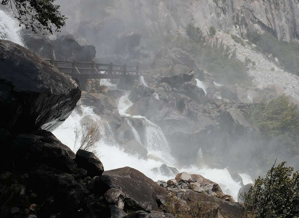 Yosemite's Wapama Falls -- the 148th tallest waterfall in the world -- roars down on the falls' footbridges above Hetch Hetchy reservoir. The bridges had been closed until recently due to the high volume of water crashing over them.