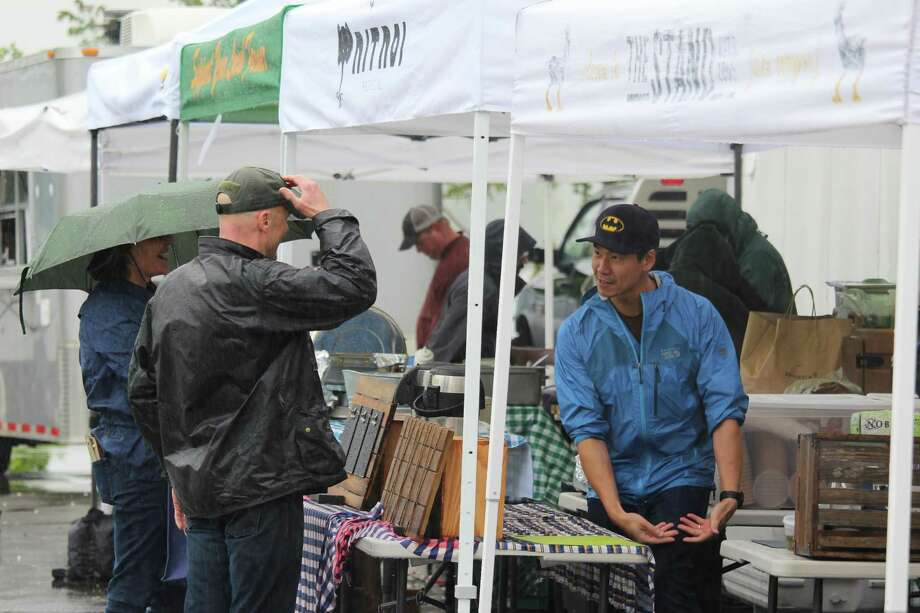 Patrons frequent the Westport Farmers Market on May 25 despite heavy rain. Photo: Chris Marquette / Hearst Connecticut Media / Westport News