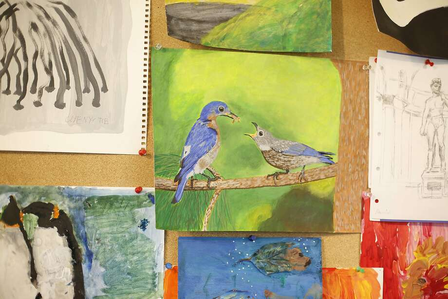 A painting by Emma Zhou is displayed along with others on a board in the art room at Laguna Honda Hospital. Photo: Lea Suzuki, The Chronicle