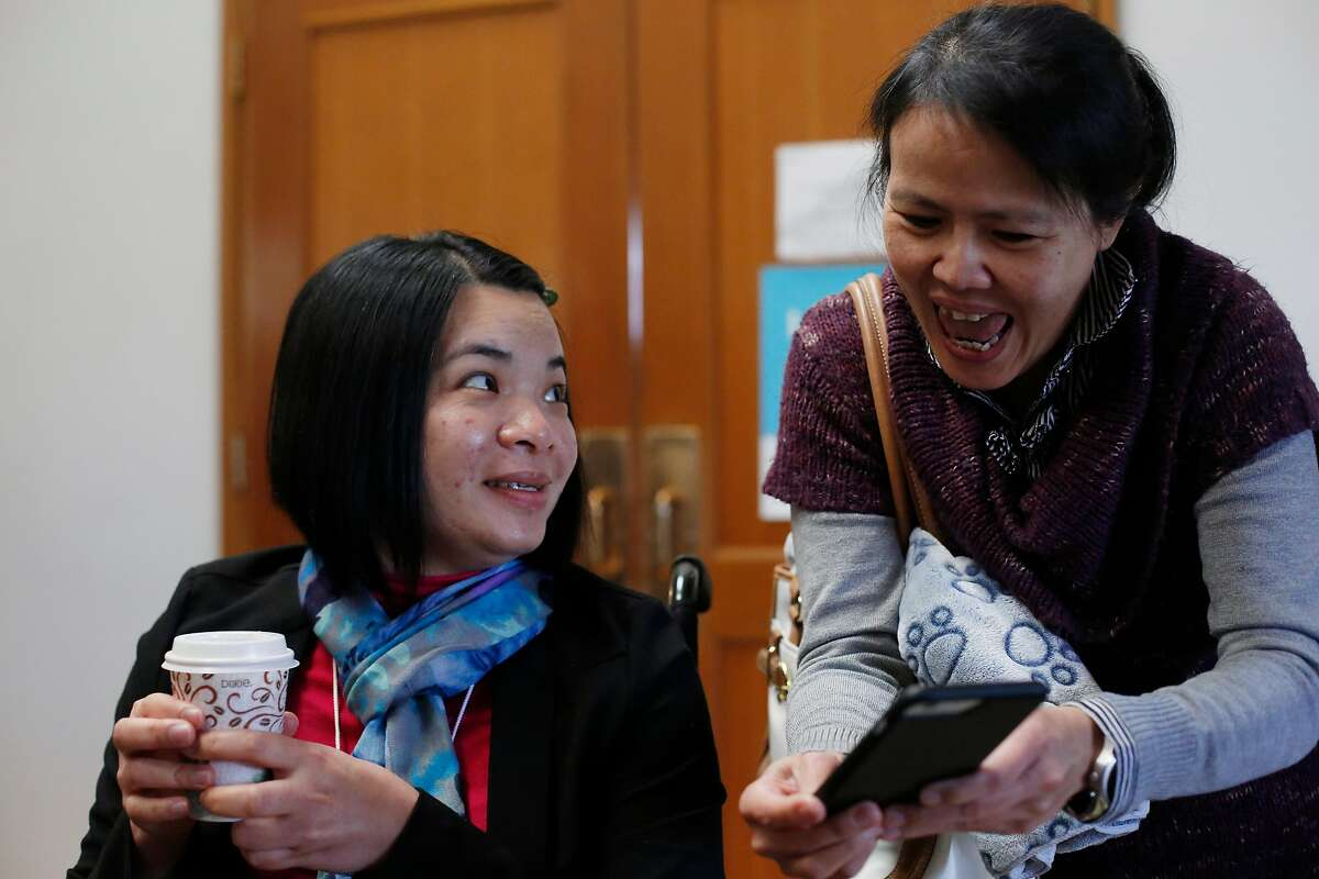 Emma Zhou (l to r) catches up wtih friend Jessica Chang during a visit to Myoshinji Temple with her family on Sunday, March 19, 2017 in San Pablo, Calif.