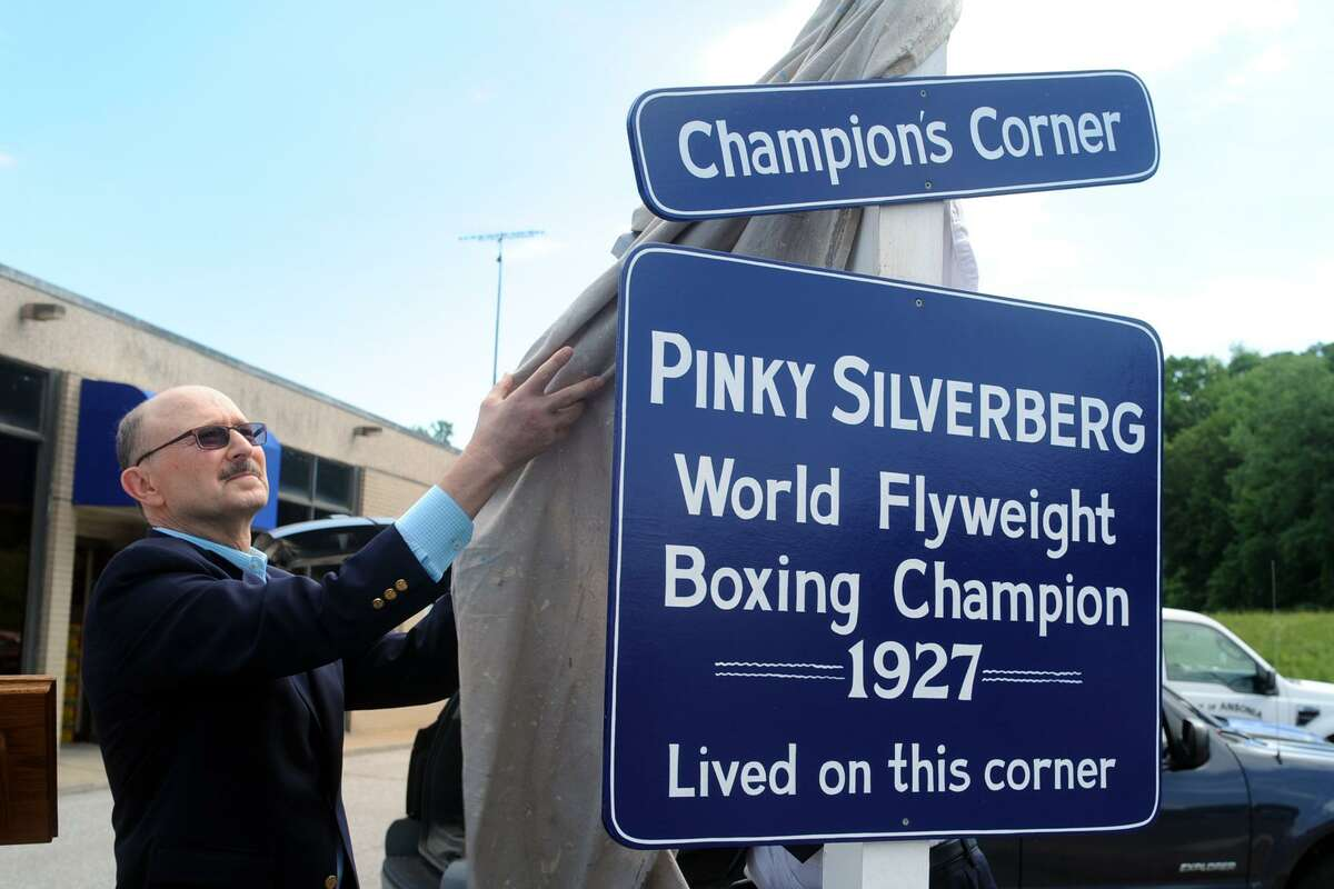 Ron Silverberg unveils a sign in honor of his father, Pinky Silverberg, a champion boxer and Ansonia native in Ansonia, Conn. June 1, 2017. Pinky Silverberg won the Flyweight Championship in 1927.