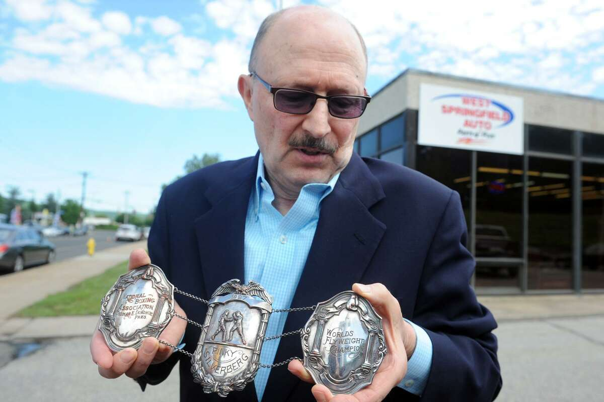 Ron Silverberg holds the decorative medals from the championship boxing belt from his father, Pinky Silverberg, in Ansonia, Conn. June 1, 2017. Pinky Silverberg, an Ansonia native, won the Flyweight Championship in 1927.