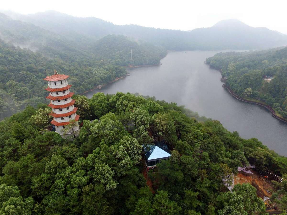 10. Hunan, China: There's a stunning historic town that quite literally hangs over the Tuo River, the world's longest glass bridge, nearly 250 sandstone peeks and hotel rates in the sub-$10 range, according to Lonely Planet. Do you need more reason to visit than that?