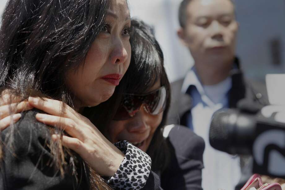 Annie Sin, first cousin of slaying victim Lina Lim, consoles Joiane Zhao, Lim's younger sister, during a news conference at the S.F. Hall of Justice in 2013. Photo: Katie Meek, The Chronicle
