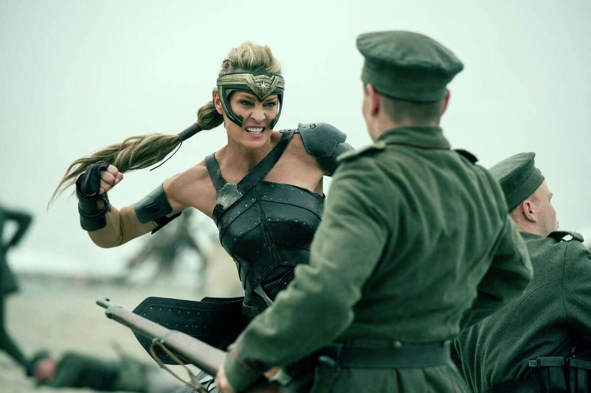 """This image released by Warner Bros. Entertainment shows Robin Wright in a scene from """"Wonder Woman,"""" in theaters on June 2. (Alex Bailey/Warner Bros. Entertainment via AP) ORG XMIT: NYET625"""