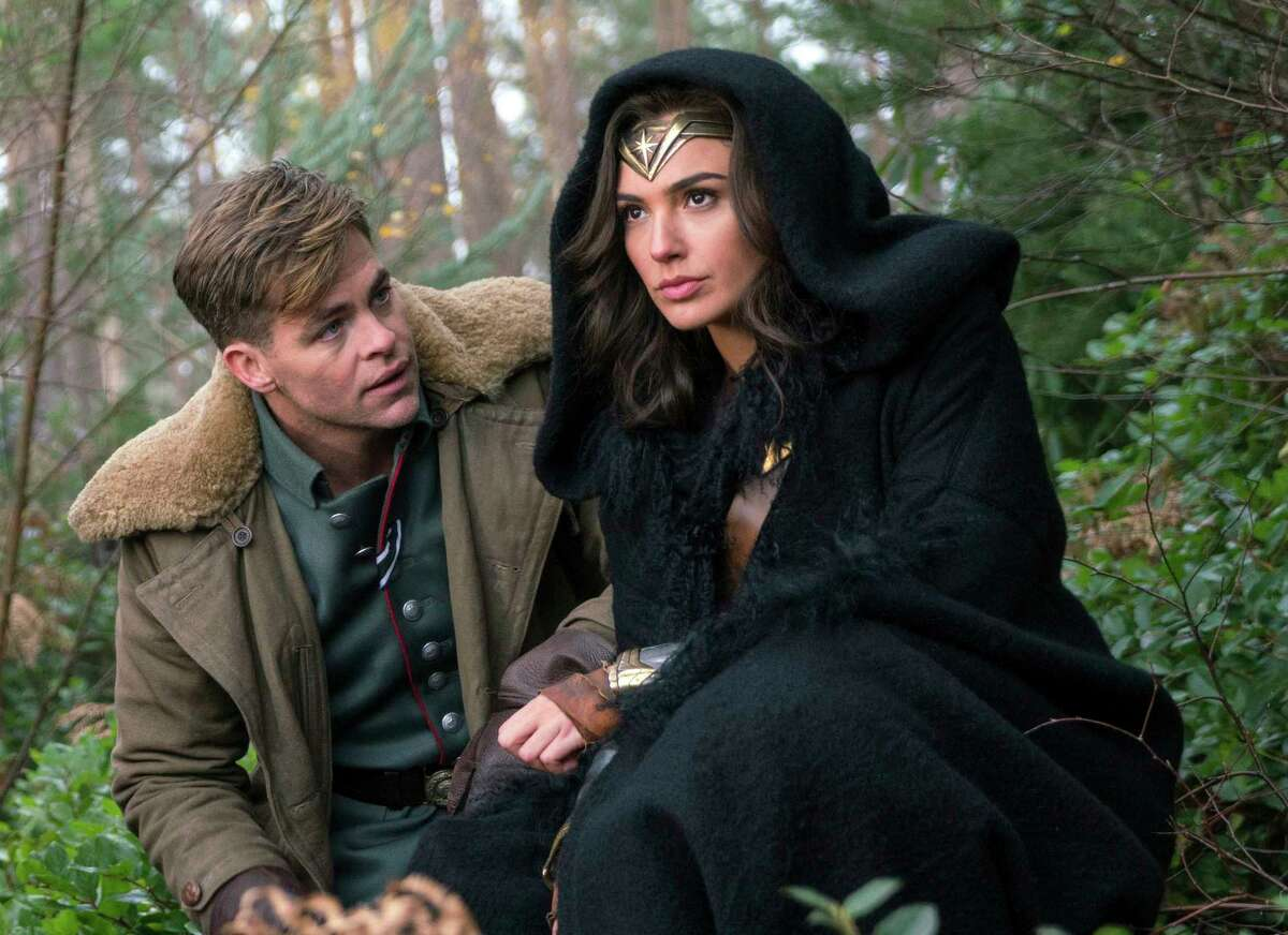 """This image released by Warner Bros. Pictures shows Chris Pine, left, and Gal Gadot in a scene from, """"Wonder Woman."""" (Clay Enos/Warner Bros. Pictures via AP) ORG XMIT: NYET621"""