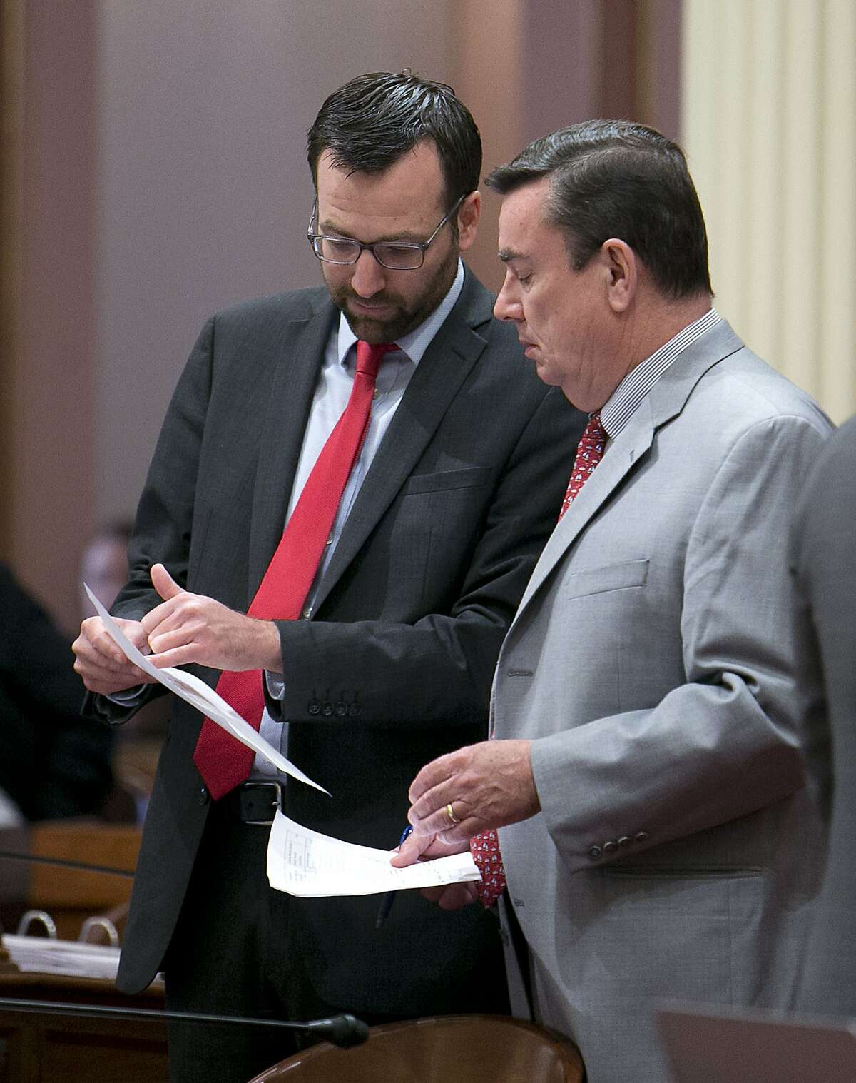 State Sen. Ben Allen, D-Santa Monica, left, discusses a bill with Sen. Joel Anderson, R-Alpine, at the Capitol, Thursday, June 1, 2017, in Sacramento, Calif. Lawmakers have until the end of this week to meet a deadline to have their bills passed out of the house of origination. (AP Photo/Rich Pedroncelli)