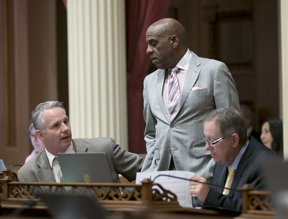 State Sen. Steven Bradford, D-Gardena, center, talks with Republican Senators Anthony Cannella, of Ceres, left, and Tom Berryhill, of Twain Harte, at the Capitol, Thursday, June 1, 2017, in Sacramento, Calif. Lawmakers have until the end of this week to meet a deadline to have their bills passed out of the house of origination. (AP Photo/Rich Pedroncelli) Photo: Rich Pedroncelli, Associated Press