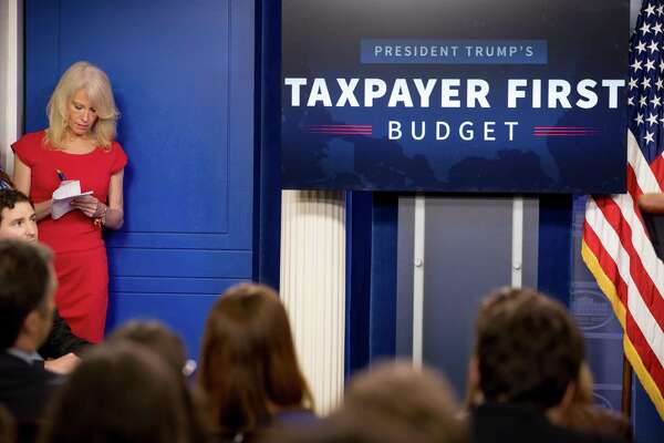 "Counselor to the President Kellyanne Conway listens as Budget Director Mick Mulvaney speak to the media about President Donald Trump's proposed fiscal 2018 federal budget. It is not a ""taxpayers first"" budget. It is a target-on-poor-Americans budget."