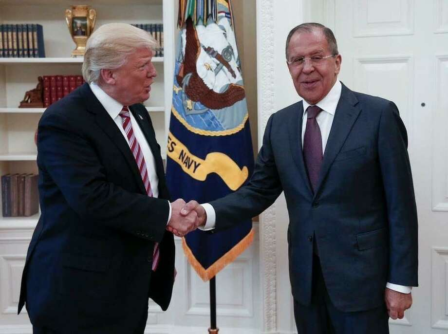 In this May 10, 2017 file handout photo released by the Russian Ministry of Foreign Affairs, President Donald Trump meets with Russian Foreign Minister Sergey Lavrov in the Oval Office. The inferences are mounting and the president needs to come clean or resign. Photo: /Associated Press / Russian Ministry of Foreign Affairs