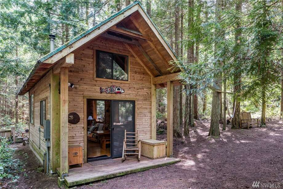 The first home, at 34 Military Rd., is this adorable cabin on Lopez Island.It has two bedrooms and an outhouse. There are two other small cabins on the property, which spans just over 5.4 acres.The home is listed for $312,000. You can see the full listing here. Photo: Listing Courtesy Heidi Hernandez, Windermere Lopez Island