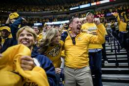 **EMBARGO: No electronic distribution, Web posting or street sales before Monday 2:01 a.m. ET May 22, 2017. No exceptions for any reasons. EMBARGO set by source.** Keri Ann Ingram and her husband, Chris, celebrate after the Nashville Predators score against the Anaheim Ducks during a playoff game at the Bridgestone Arena in Tennessee, May 18, 2017. Having overcome wobbly attendance during their formative years, the Predators sold out all 41 regular-season games at Bridgestone Arena and all eight so far in the playoffs. (Joe Buglewicz/The New York Times)