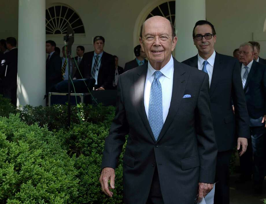 "With manufacturing jobs to fill, companies should be plying high school students and their parents ""with cocktails and hors d'oeuvres"", says billionaire U.S. Commerce Secretary Wilbur Ross. Photo: Susan Walsh, AP / Copyright 2017 The Associated Press. All rights reserved."