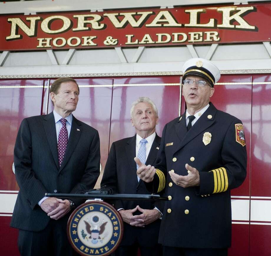 U.S. Senator Richard Blumenthal stands with Norwalk Mayor Harry Rilling and Acting Fire Chief Gino Gatto at Norwalk Fire Department Headquarters to announce a new federal grant for the Norwalk Fire Department. Photo: Scott Mullin / For Hearst Connecticut Media / The News-Times Freelance
