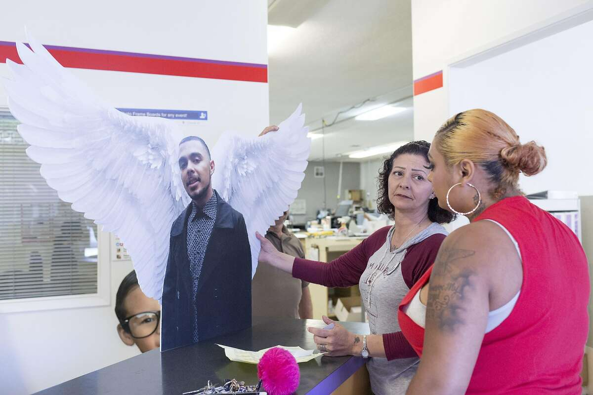 Annice Evans, center, mother of Angel Ramos (in cutout), speaks with Ramos' sister Alicia Saddler June 1, 2017 in Vallejo, CA. Evans and Saddler were picking up a cutout of Ramos at a print shop for his birthday. If Ramos were alive, he would be 22 years old on June 3. However, he was shot by Vallejo police during a January scuffle outside the home he shared with his mother, sister and other family members.