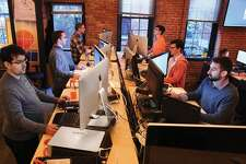 CAMBRIDGE, MA - COTOBER 27: HubSpot employees work at their standing desks, on Monday, October 27, 2014. Front to back on left are: Rodolfo Carvalho, Matt Veitas and Andy Corcoran. Front to back on right are: Ryan Getchell, Joss Poulton and Logan Hotchkiss. (Photo by Pat Greenhouse/The Boston Globe via Getty Images)