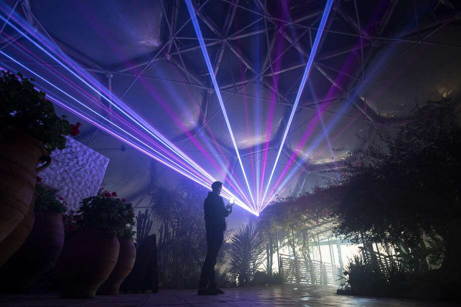 ST AUSTELL, ENGLAND - NOVEMBER 23:  The Eden Festival of Light and Sound lasers illuminate the interior of the Mediterranean Biome at The Eden Project on November 23, 2016 in St Austell, England.  A new laser light and sound show curated by acclaimed light artist Chris Levine aims to bring all the colours of Christmas to Eden and will run from on selected nights from tomorrow to December 30 at the home of the world-famous Biomes in Cornwall. Visitors standing on the viewing platform will be able to watch lasers pierce through the darkness to create a canopy of light, painting the Biomes and the plant displays with festive colours whilst inside the Mediterranean Biome there will be the stage for a choreographed performance of after dark music and light.  (Photo by Matt Cardy/Getty Images) Photo: Matt Cardy/Getty Images