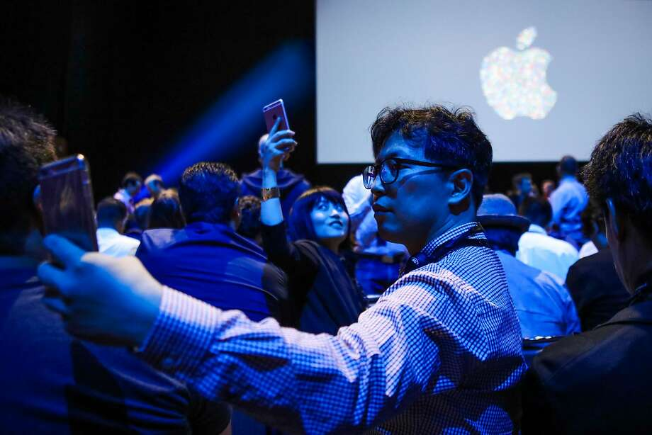 Osen Pilju Kang takes a selfie with the Apple logo, ahead of a Apple's annual Worldwide Developers Conference presentation in San Francisco in June 2016. Photo: GABRIELLE LURIE, AFP/Getty Images