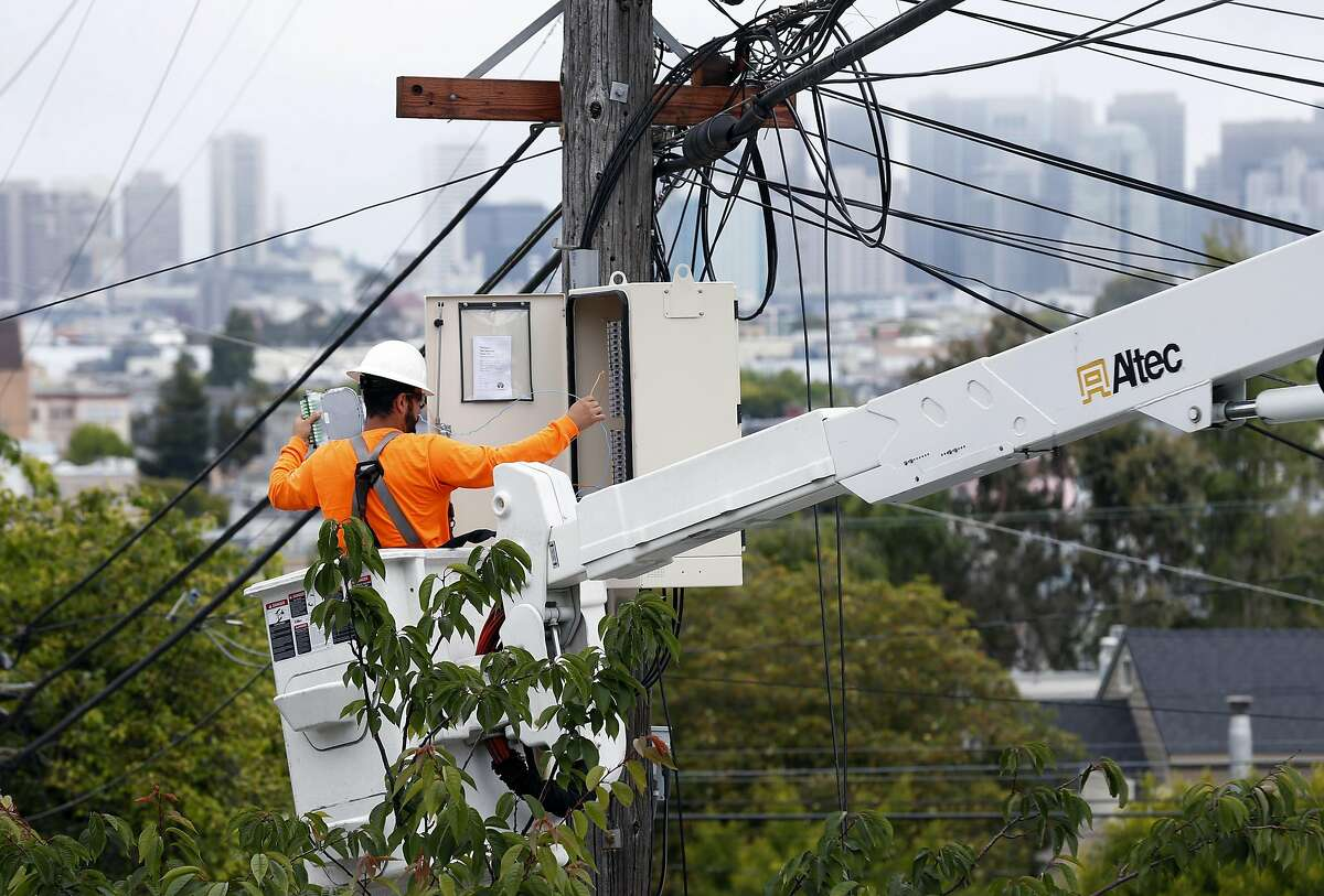 Carlos Contreras completes the installation of fiberoptic equipment into a utility pole junction box for Sonic's gigabit fiber internet service on Alabama Street near Precita Park in San Francisco, Calif. on Thursday, June 1, 2017.