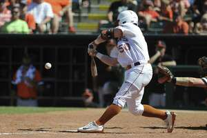 Texas' Zane Gurwitz connects with the ball in the championship game in the Big 12 baseball tournament in Oklahoma City on May 28, 2017.